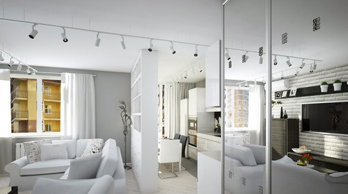 трековые светильники в интерьере белой комнаты